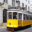 Typical yellow tram on the street of Lisbon — Stock Photo