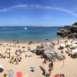 Stock Photo: People sunbathing on the beach in Cascais, Portugal