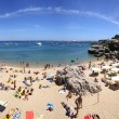 People sunbathing on the beach in Cascais, Portugal — Stock Photo #30881485