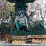 Bronze fountain at Rossio square in Lisbon — Stock Photo