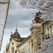 Buildings at the street reflecting in a puddle after rain — Stok fotoğraf