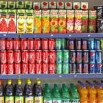 Bottles of soft drinks on a market shelves — Stock Photo #37550923