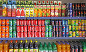 Bottles of soft drinks on a market shelves — Foto de Stock
