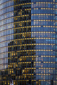 Skyscraper with office windows and glass background — Stock Photo