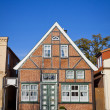 Facade of typical German residential house in Lubeck — Stock Photo #39346187