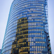 Skyscraper with office windows and glass background — Stok fotoğraf