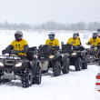 Постер, плакат: Quad bike drivers rides over snow track