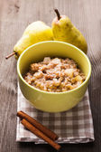 Oatmeal with pears slices — Stock Photo
