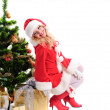 Christmas santa girl with gift — Stock Photo #15653473