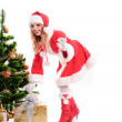 Christmas santa girl with gift — Stock Photo #15653557