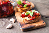 Bruschetta with sun dried tomatoes — Stock Photo