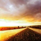 Wet road and sky — Stock Photo