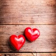 Red hearts on wood — Stock Photo #19589869
