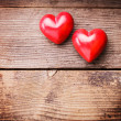 Red hearts on wood — Stock Photo #19589917