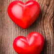 Red hearts on wood — Stock Photo #19589979