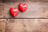 Red hearts on wood — Stock Photo