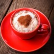 Red cup with cappuccino — Stock Photo #19612093