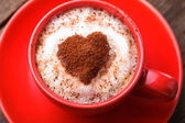 Red cup with cappuccino — Stock Photo