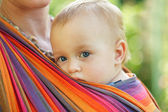 Baby in sling — Stock Photo