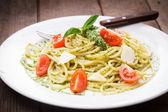 Spaghetti with green pesto — Stock Photo