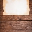 Aged paper on wood — Stock Photo #23883841