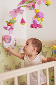 Baby stay in the bed — Stock Photo