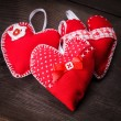 Handmade red hearts - Stock Photo
