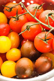 Various types of cherry tomatoes — Stock Photo