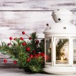 Cristmas lantern with fir and berries — Stock Photo
