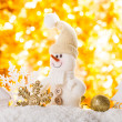 Snowman on gold — Stock Photo
