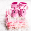 Knitted baby booties — Stock Photo