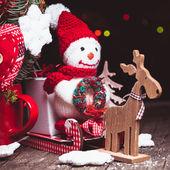 Boneco de neve em trenós — Fotografia Stock