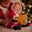 Stock Photo: Christmas baby and mom