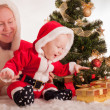 Christmas baby and mom — Stock Photo