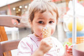 Girl eats an ice cream — Stok fotoğraf