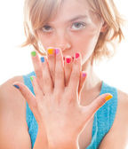 Girl with rainbow nails — Stock Photo