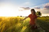 Girl on wheat fieald — Stock Photo