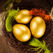 Stock Photo: Golden eggs in the nest