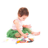 Toddler girl paints on the paper — Stock Photo
