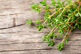 Thyme on the wooden table — Стоковое фото