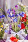 Wildflowers in bottles — Stock Photo