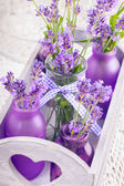 Lavender in bottles decor — Stock Photo