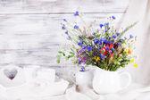 Wildflowers in bottles — Stock Photo