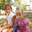 Two sisters on the carousel — Stock Photo #51753345