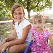 Two sisters on the carousel — Stock Photo