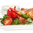 Roasted chicken with vegetables on a white plate — Stock Photo #12341323