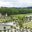 Famous palace Versailles near Paris, France with beautiful garde - Stock Photo