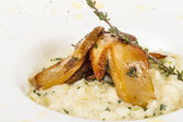 Photo of delicious risotto dish with herbs and mushrooms on whit — Stock Photo