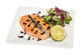 Savory fish portion : roasted norwegian salmon fillet garnished — Stock Photo
