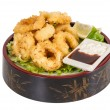 Stock Photo: Deep batter fried squid rings calamari with green salad